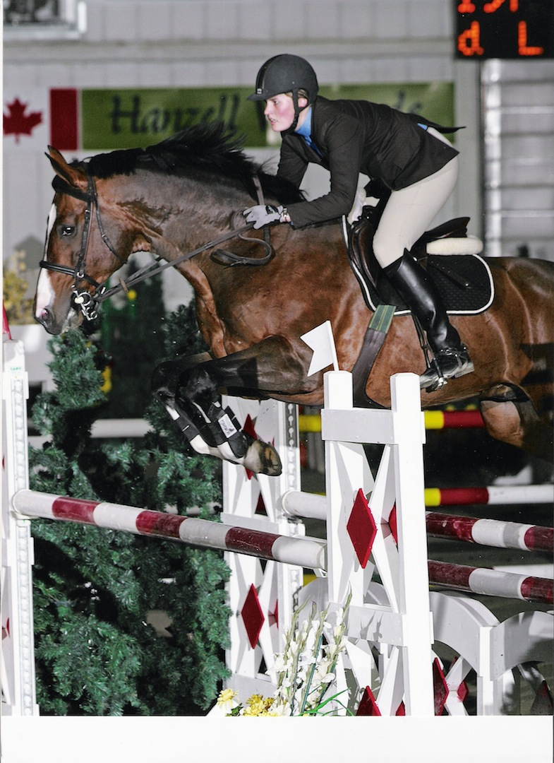 Portland L with Beke Brinkmann as a young rider in Spruce Meadows indoor tournament